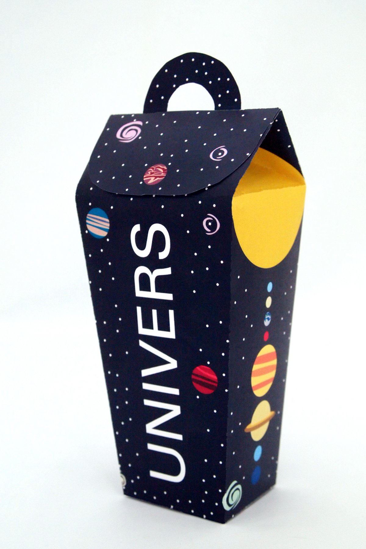 A corner shot of the front of the package and the right side showing an illustration of the solar system.